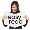 lady holding a sign which is white with black text which says easy read